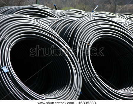 Stock photo rolls of black water pipes 16835383